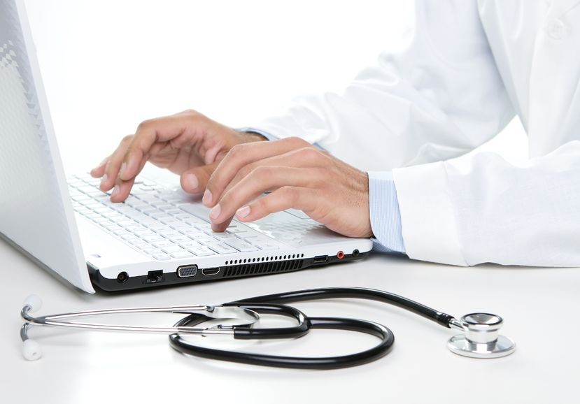 15201559 - close up of male doctor working on a laptop